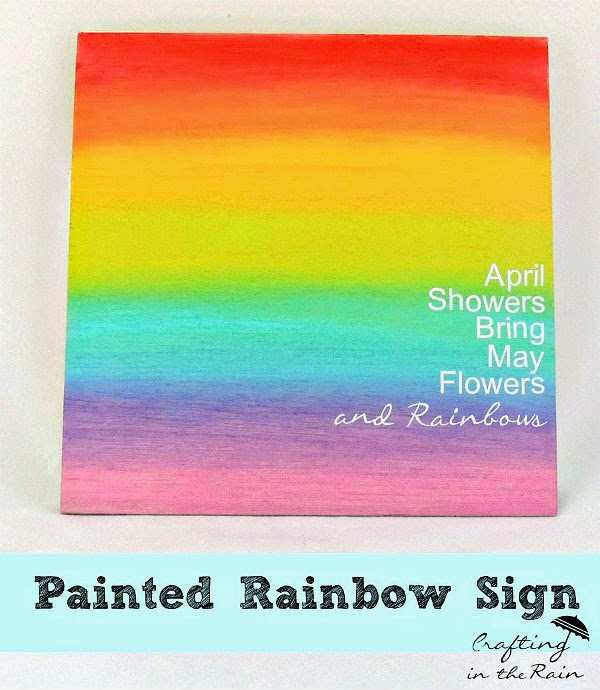 http://www.craftingintherain.com/2014/05/painted-rainbow-sign.html