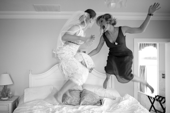 bride and mom jumping