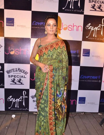 Celina Jaitley in Backless Green Saari at Launching Jashns Calendar wallpapers