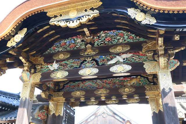 A closer look at the beauty designs of colourful and gold plated of wood carving on Karamon Gate at Nijo Castle in Kyoto, Japan