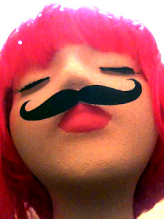 Styrofoam head with pink hair and mustache for contest