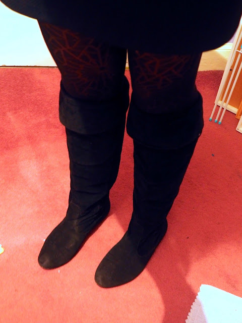 Knee high black suede boots with top folded down