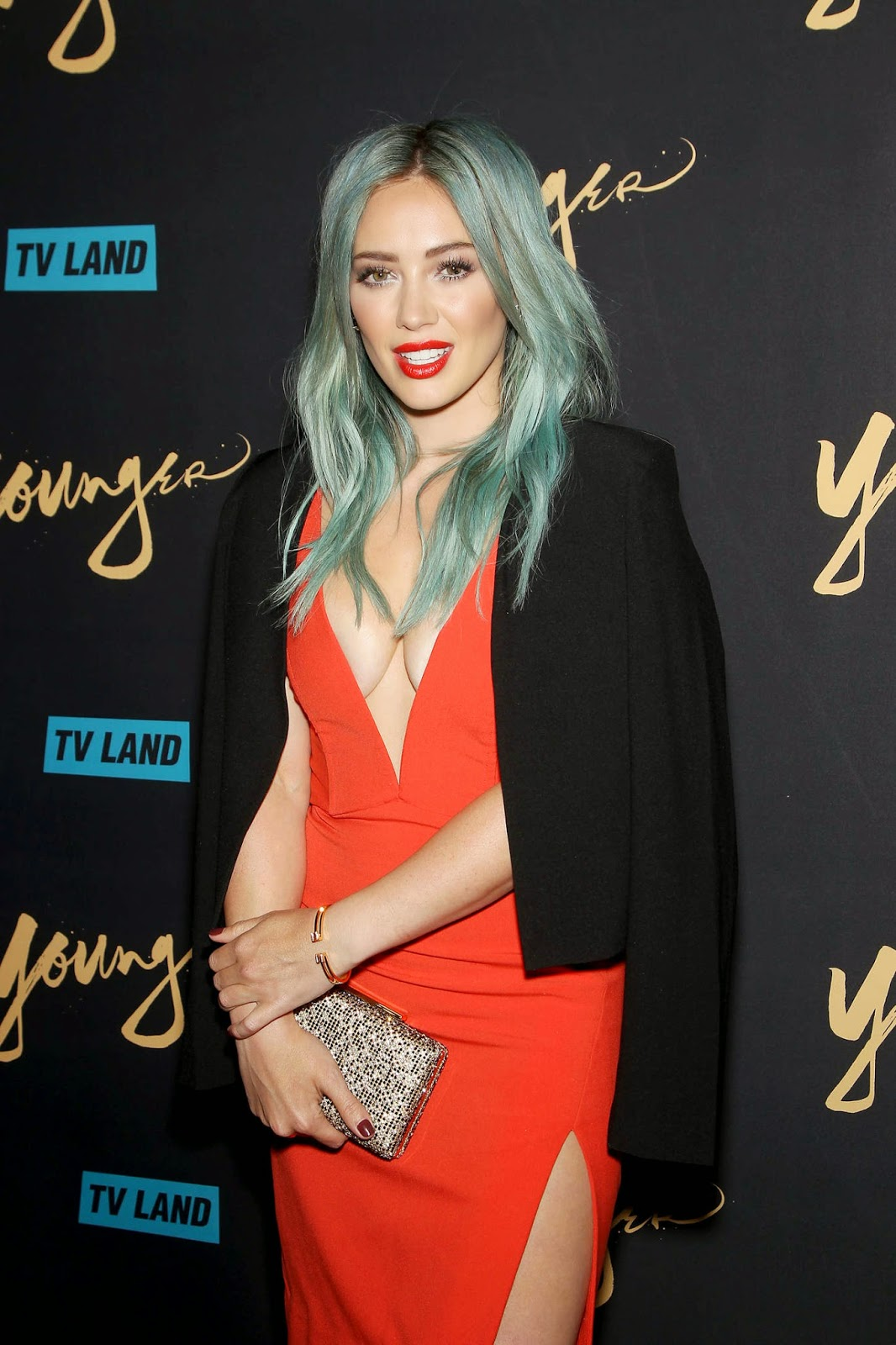Hilary Duff bares cleavage in a low cut dress at the 'Younger' premiere in NYC