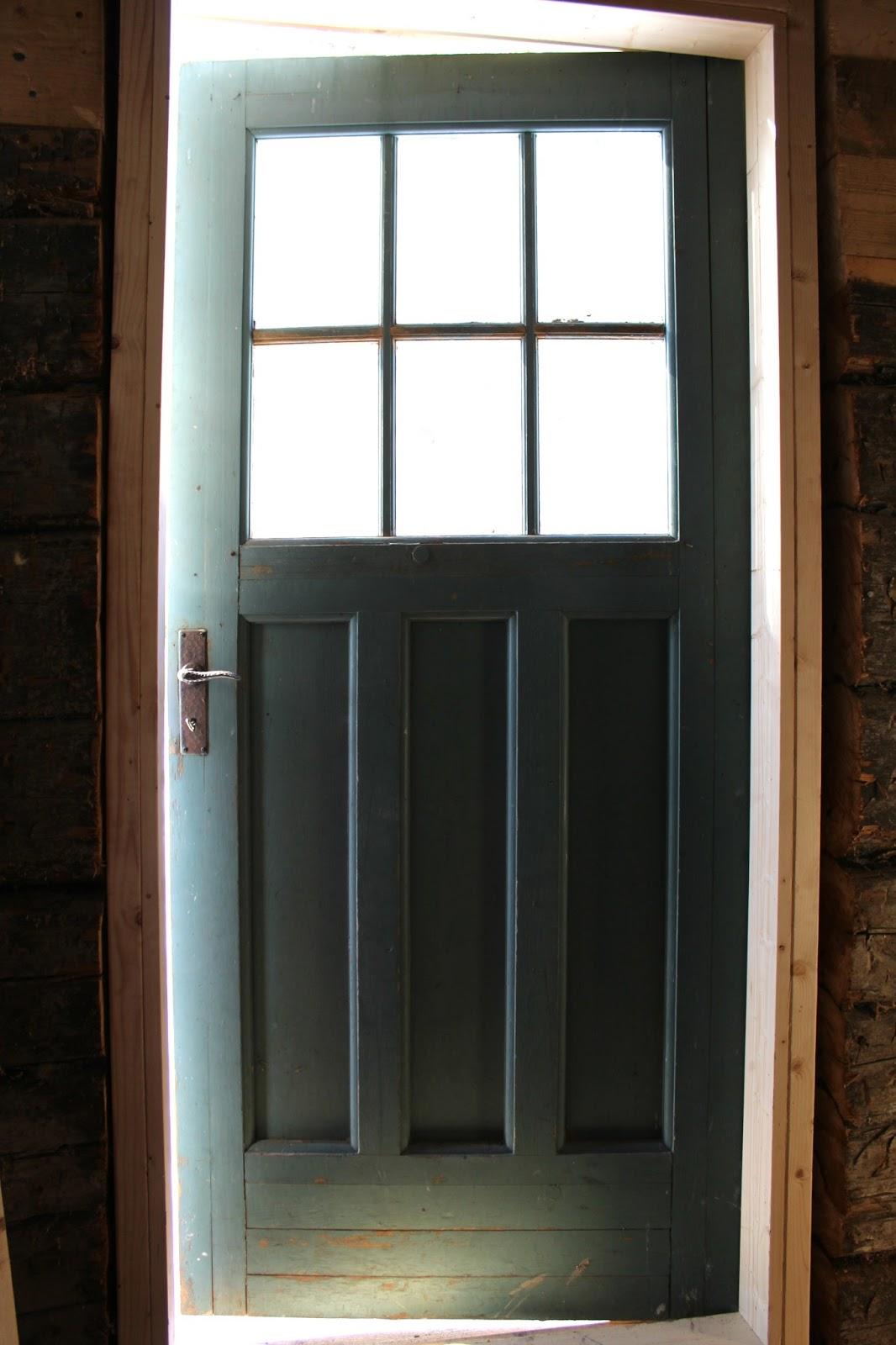 PåÖstergården begagnad spröjsad dörr