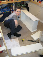 Joshua assembling flat pack furniture
