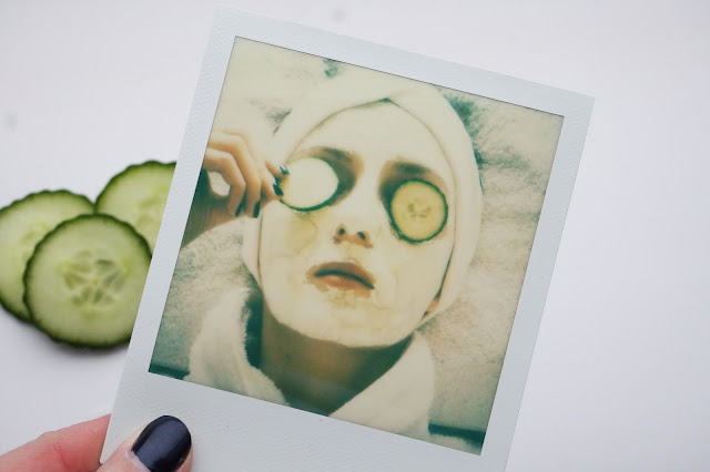 Polaroid photo of girl wearing a cucumber face mask