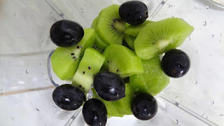 Preparing Kiwi and Grapes Smoothie