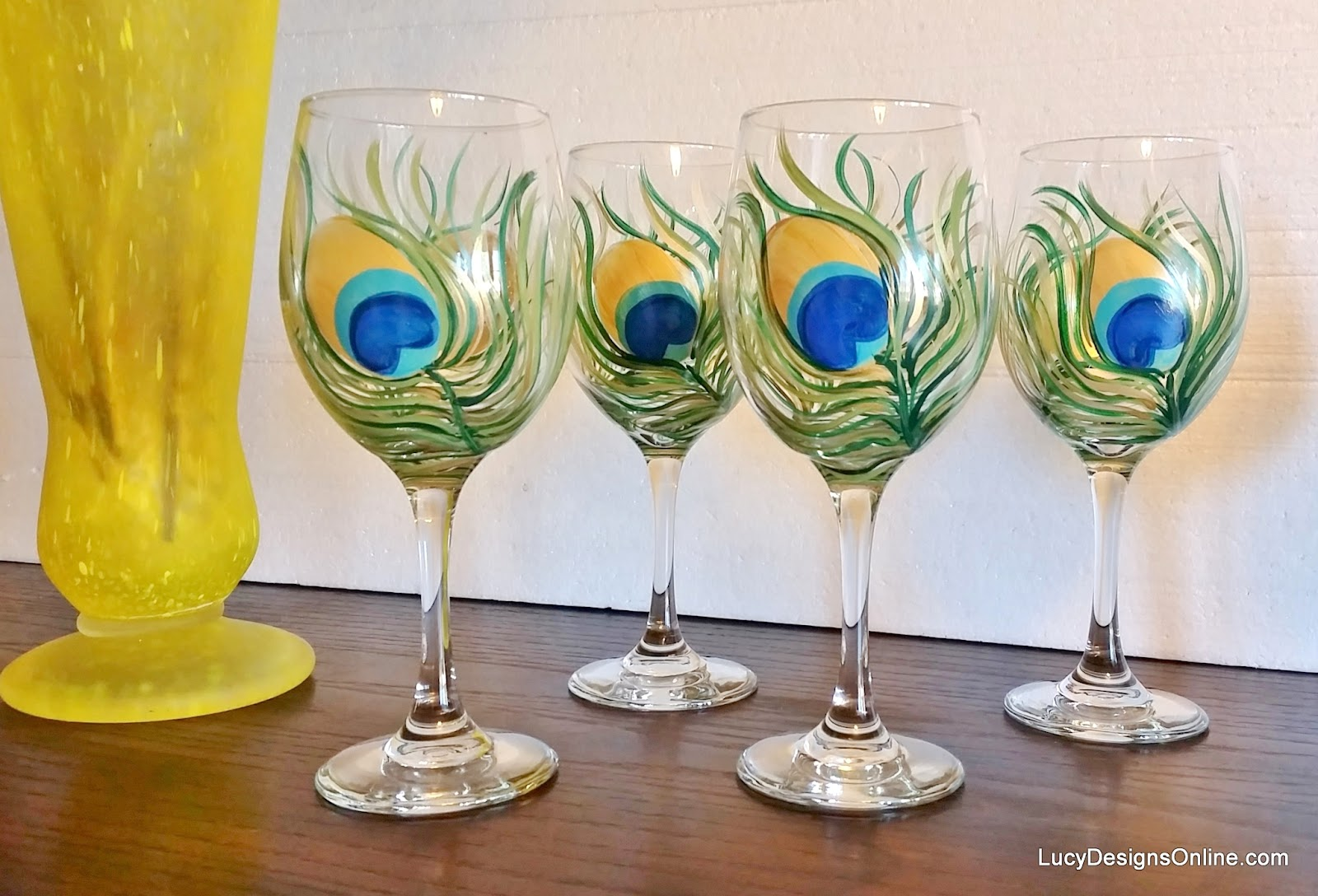 Diy hand painted wine glasses with peacock feather design for Type of paint to use on wine glasses