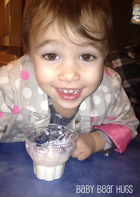 toddler girl eating ice cream