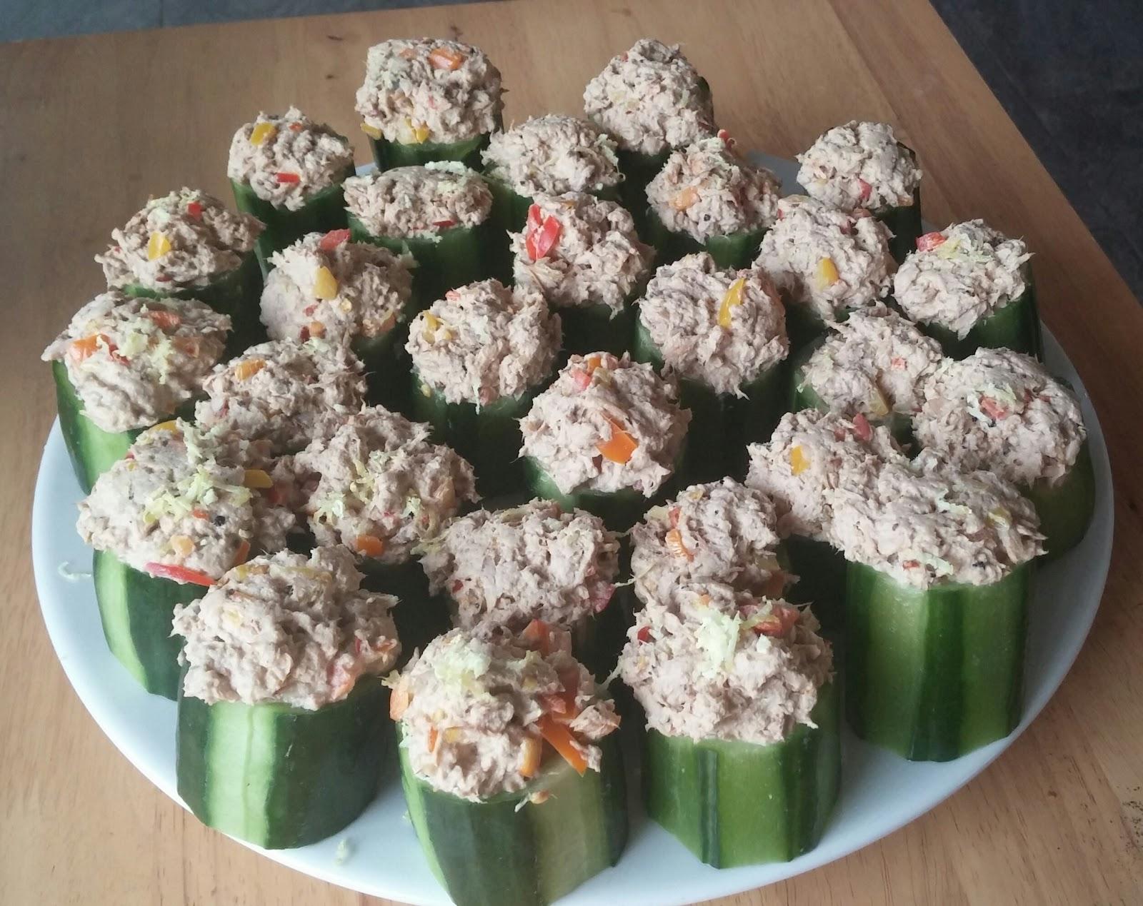 tuna and mixed peppers mixed with spicy mayonnaise stuffed into little cucumber cups