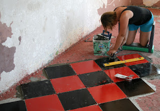 A gets cracking on with the Room 13 tiles