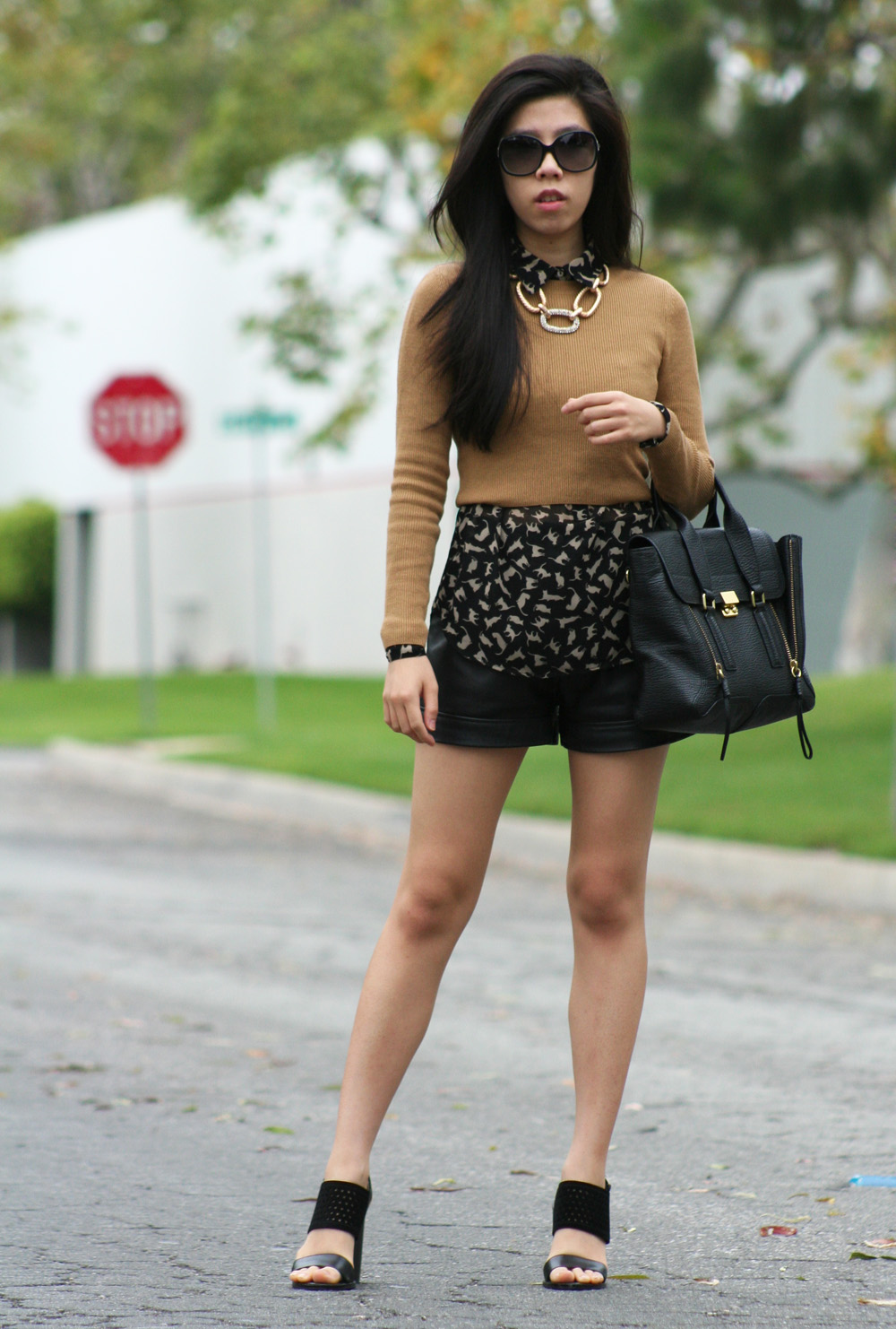 how to look sophisticated in black leather shorts
