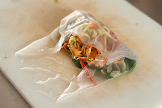 veggies being rolled in spring roll
