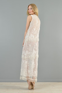 Vintage white lace maxi dress with beaded details and embroidered flowers.