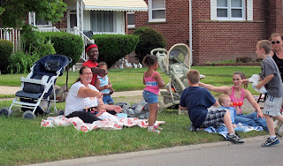 typical family watching the memorial day parade