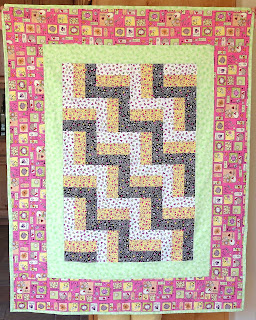 pink and green focused quilt for a girl