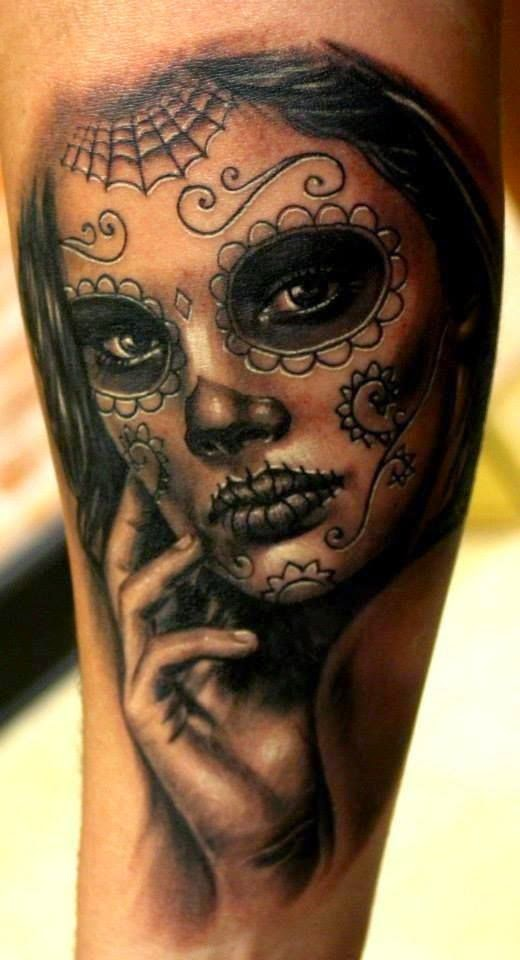 Sugar skull black ink tattoo on arm