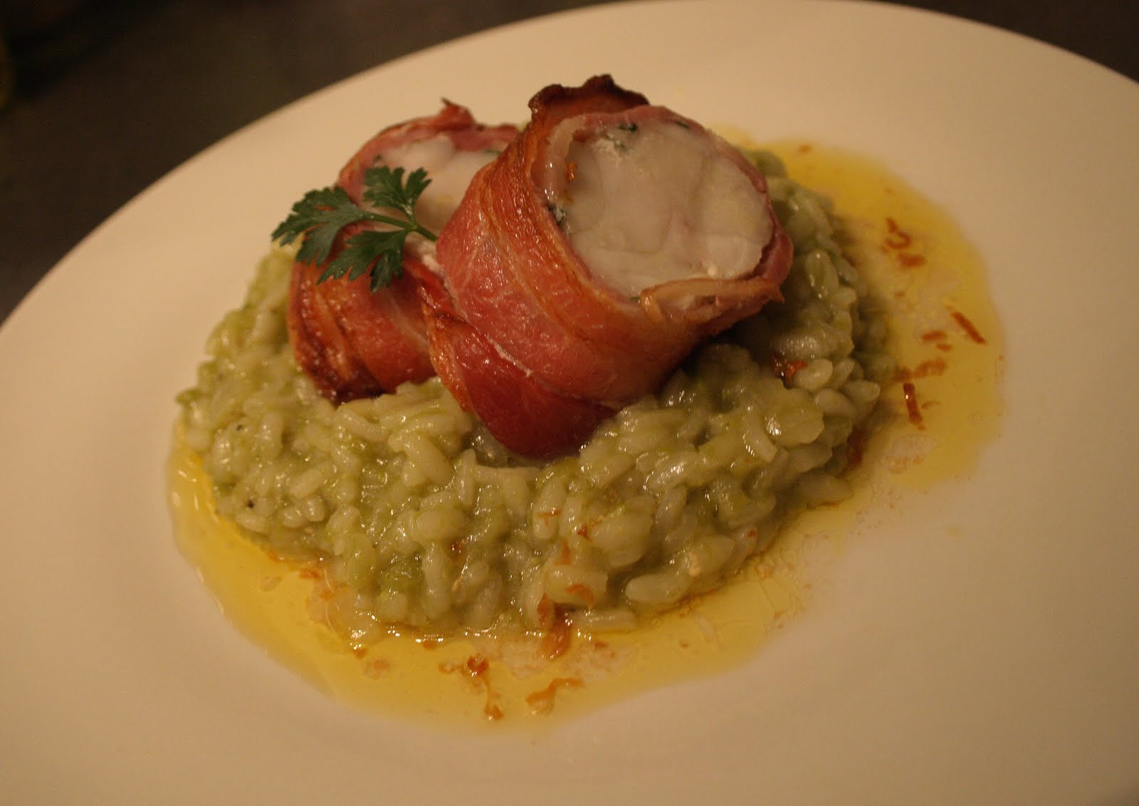 Bacon Wrapped Monkfish On Pea Risotto With A Burnt Lemon Butter