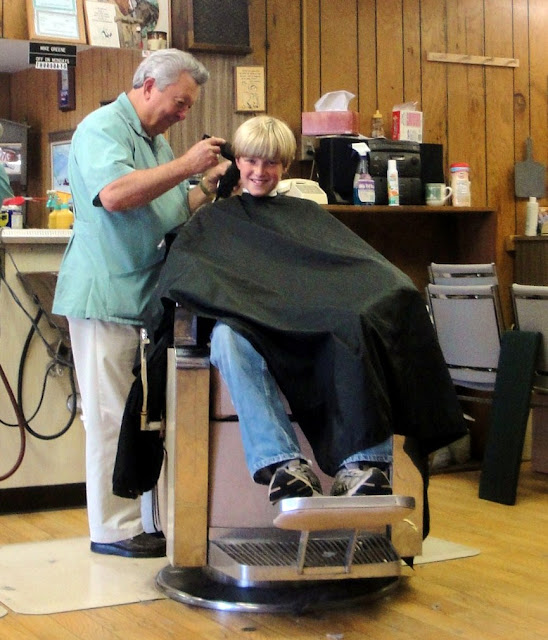 Woman Sitting in Barber Chair