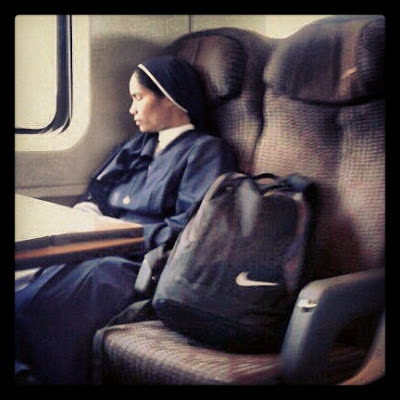 Nun sleeping on an Italian train