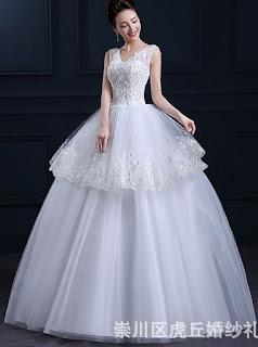Vestido de novia corte princesa con tirantes de tul, apliques brillantes y falda con dos capas