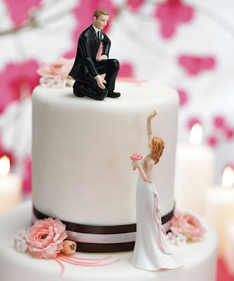 lending a hand wedding cake topper