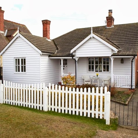 1930s beach bungalow in white completely coastal for Beach house plans uk