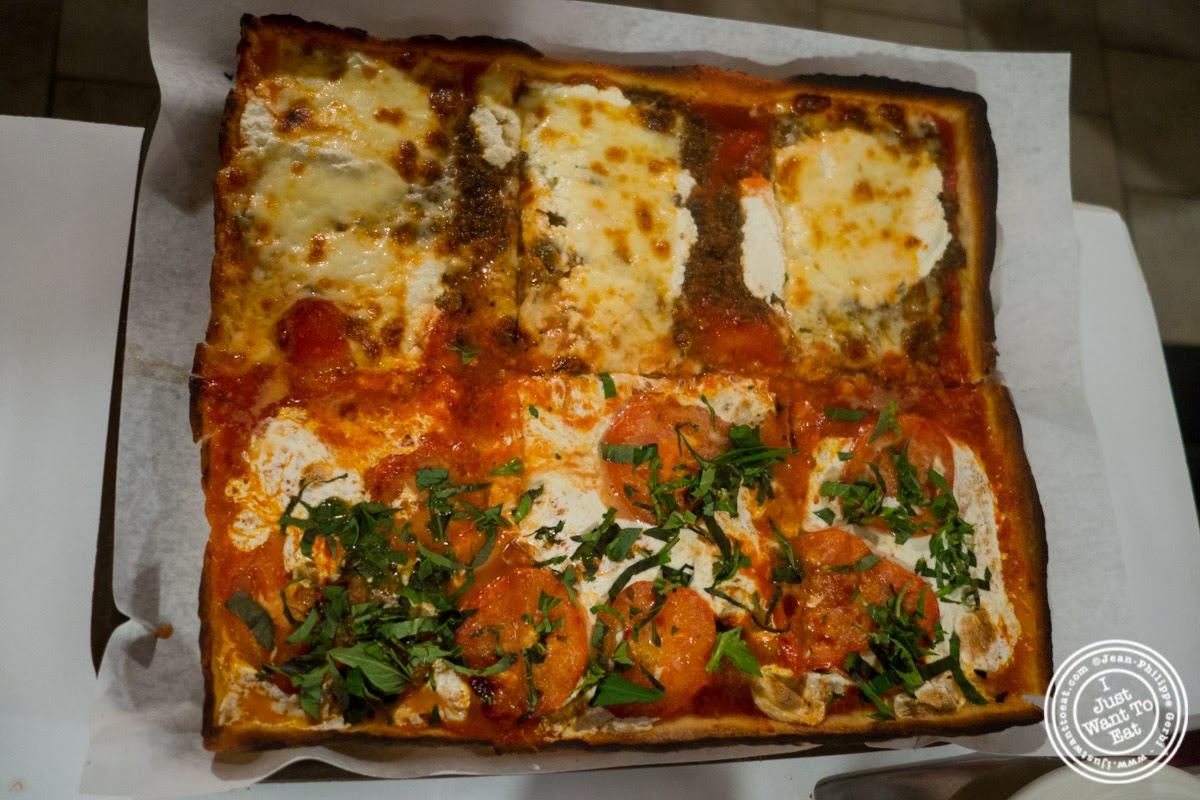 image of lasagna and margherita pizza at Lazzara's Pizza and Café in the Garment District, NYC, New York
