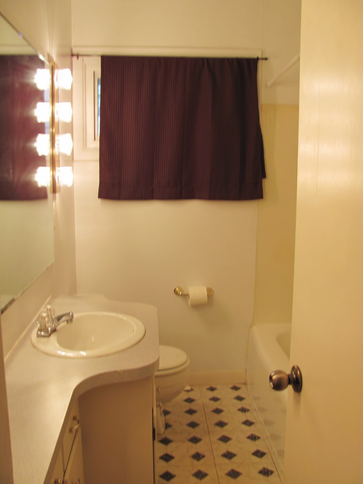The bathroom is seen with the light on
