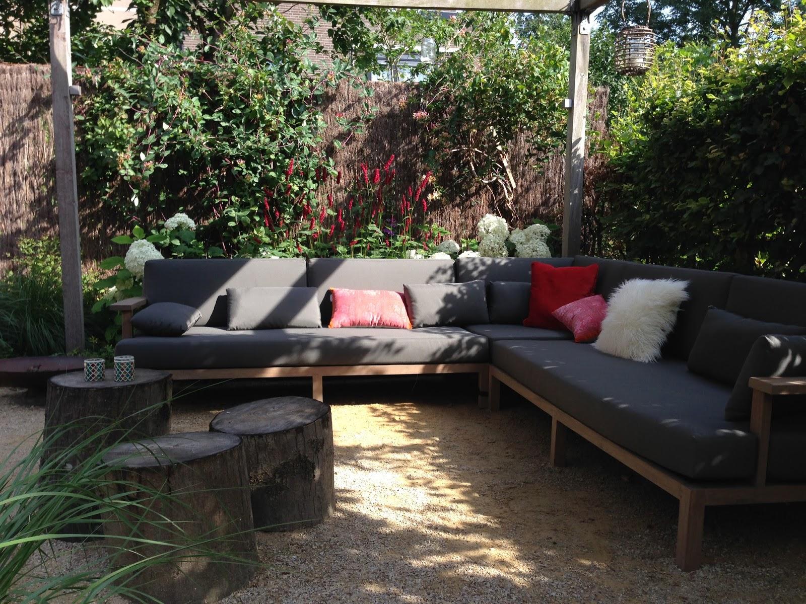 Cyntuinen tuinontwerp &  advies: tuin met cortenstaal bij hoekwoning