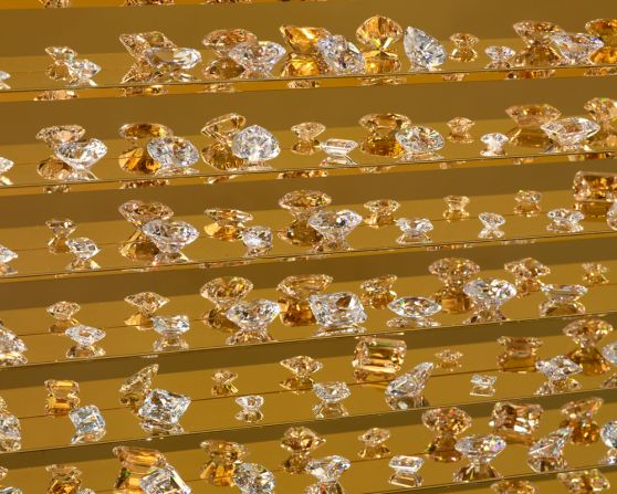 close up of man made diamonds on gold shelves in gold cabinet
