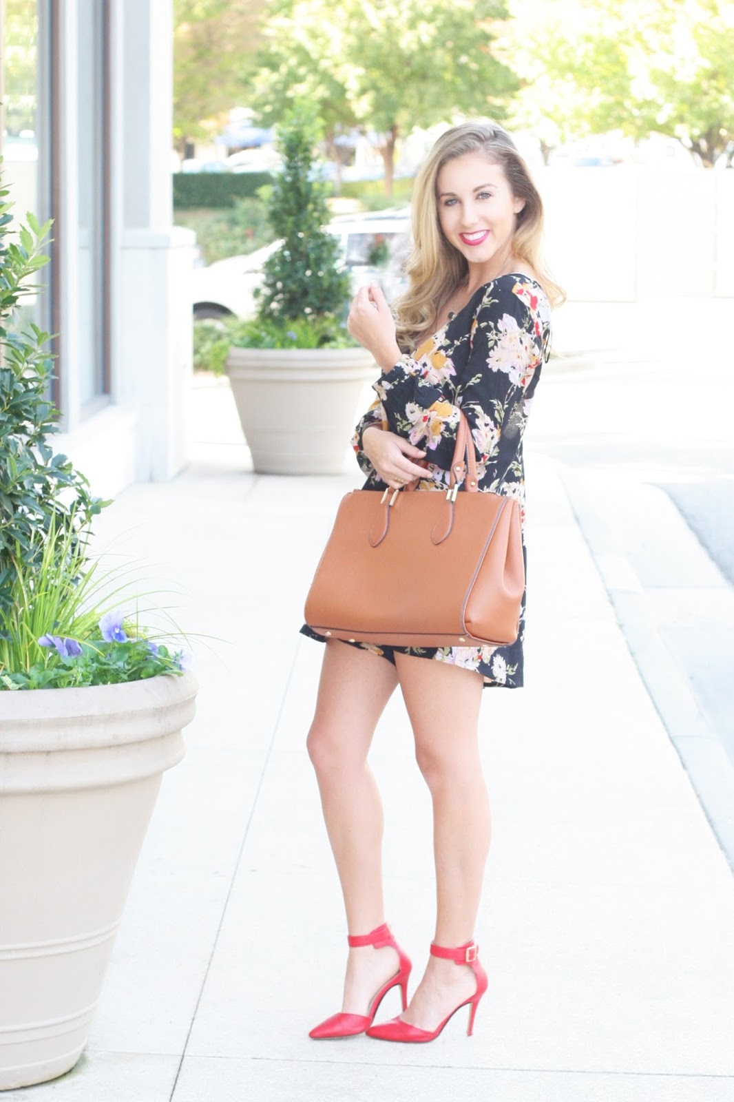 Statement-romper-with-camel-tote-and-red-heels