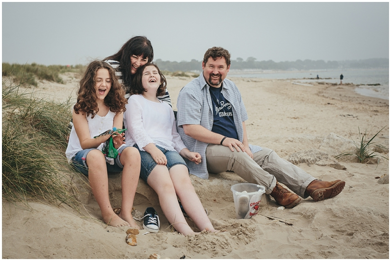 Relaxed family portrait on the beach