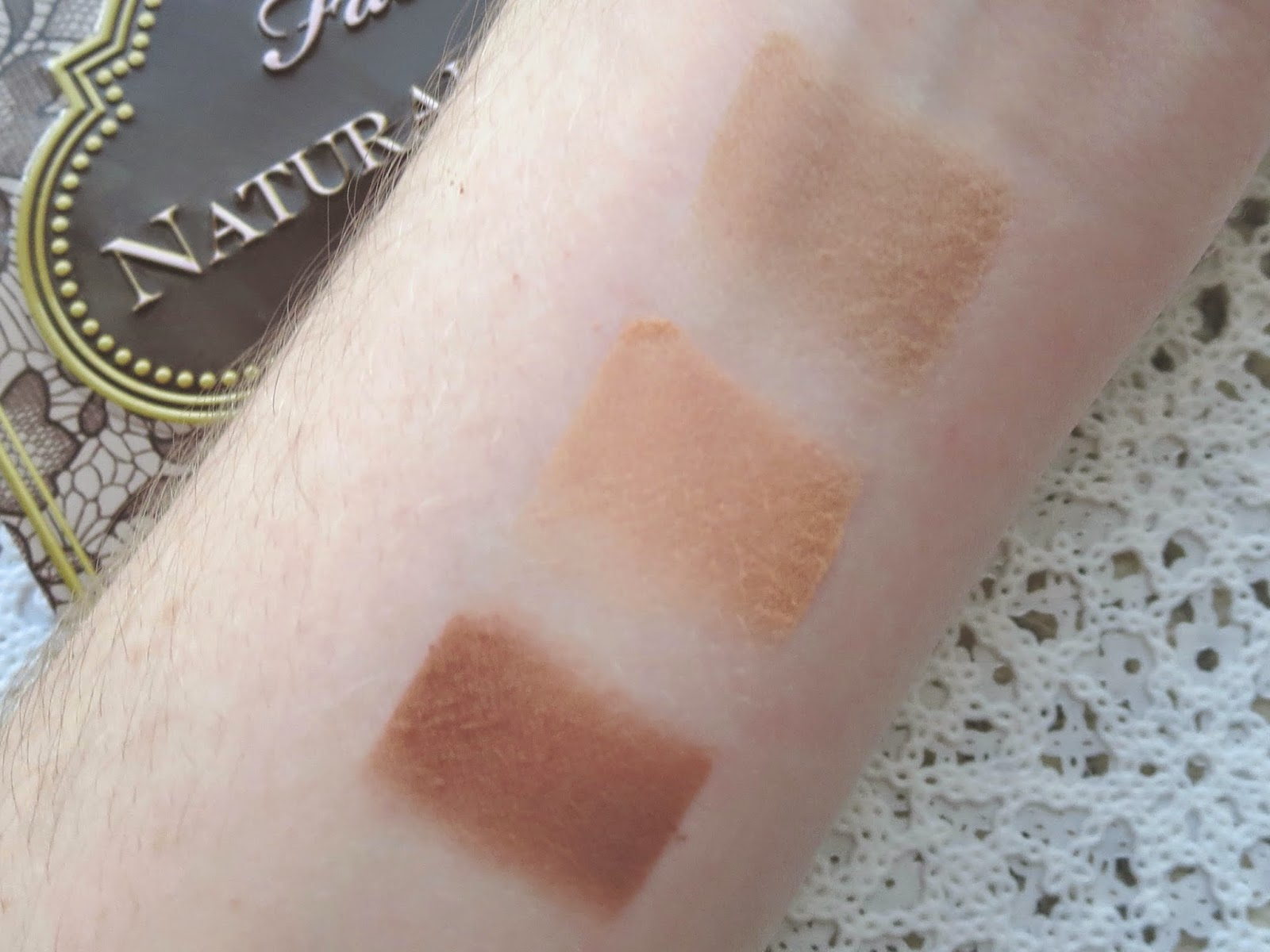 a picture of Too Faced Natural Matte palette swatch; Chocolate Cookie, Honey Butter, Nudie