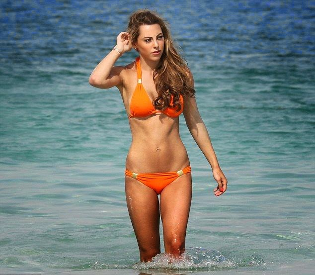 In Thursday,‭ ‬May‭ ‬22,‭ ‬2014,‭ ‬the buxom, Dani Lawrence showed off incredible anatomy as she accentuated her glory in an orange bikini.