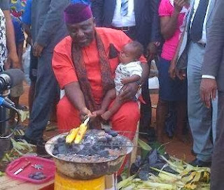 Governor Rochas Okorocha roasting corn