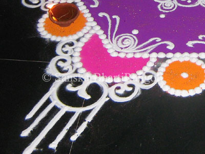with white rangoli below are close ups of the above rangoli design
