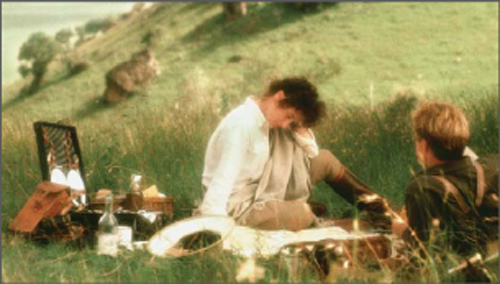 Meryl Streep and Robert Redford picnic in a scene from the movie Out of Africa