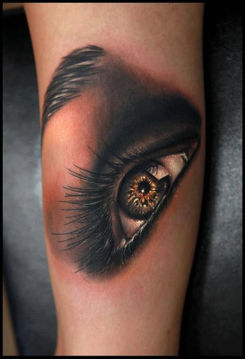 See more 3D realistic eye tattoos on arm