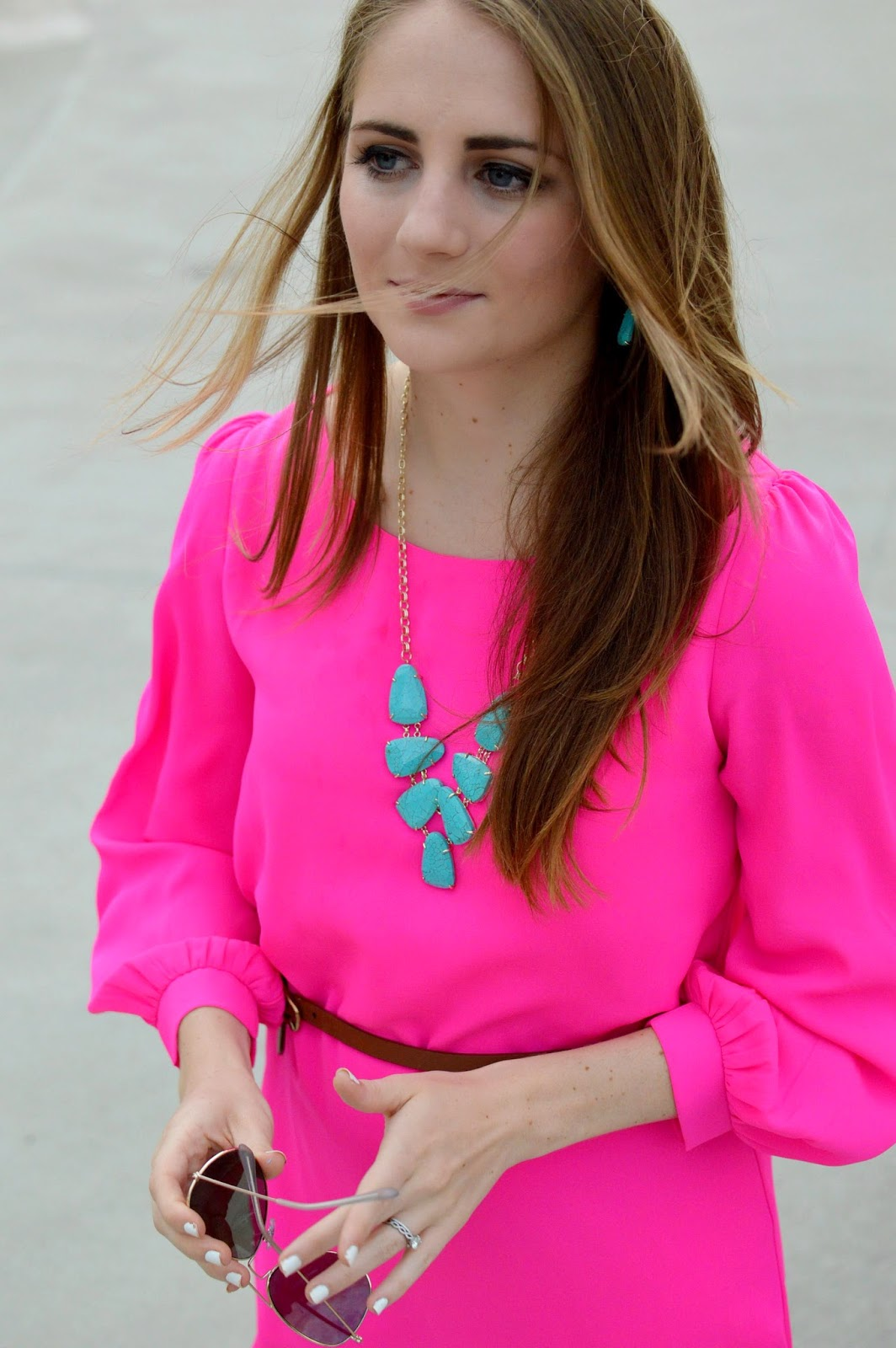 pink dress with turquoise accessories