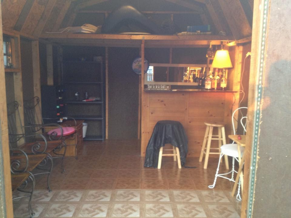 the barshed: shed into bar- moving in the furniture