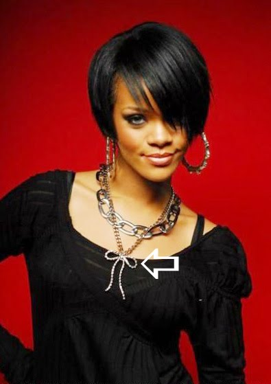 Rihanna wearing a silver rhinestone bow necklace by Jenny Dayco