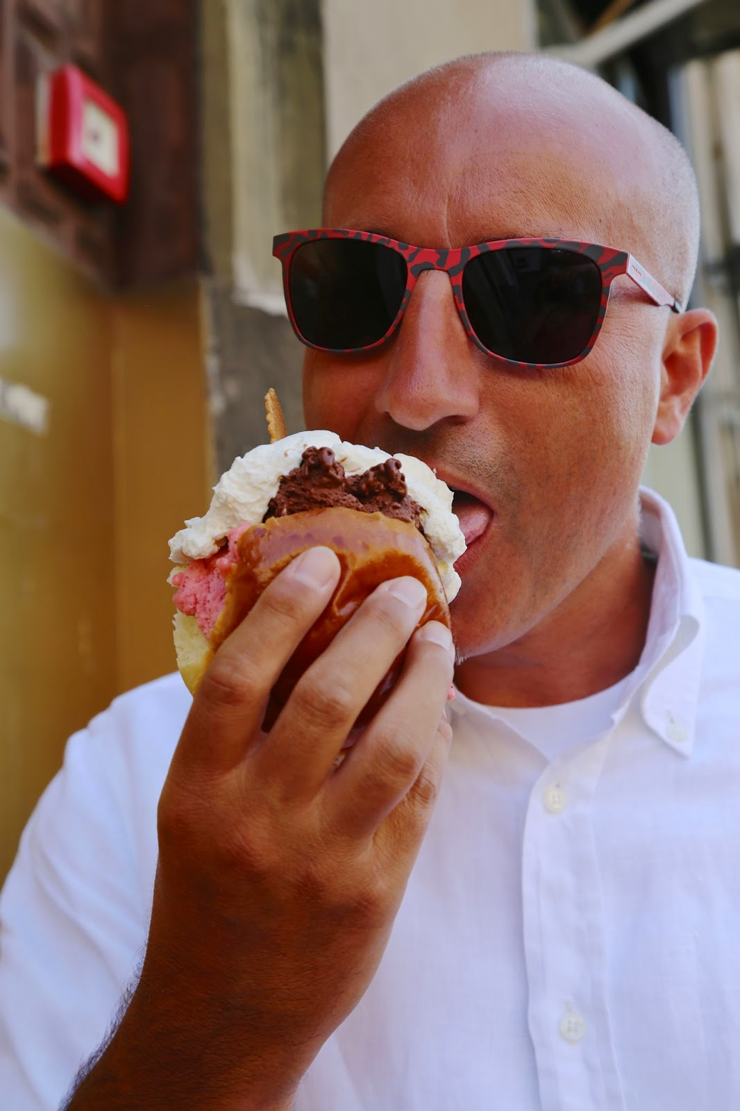 Sicilian eating ice cream sandwich, Palermo, Sicily