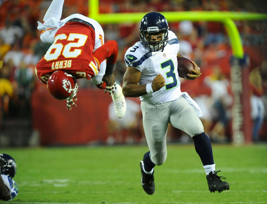 Seahawks QB Russell Wilson runs from defenders