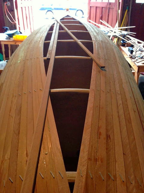 building wood striped canoe: simple living and eating