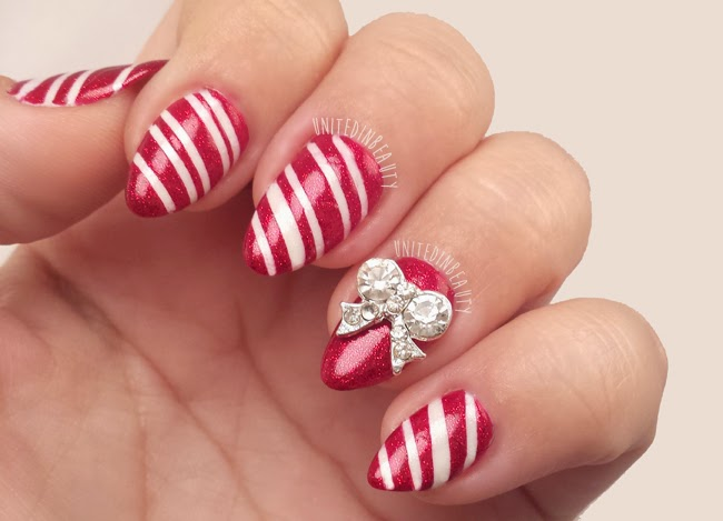 Christmas Candy Cane Nails by @UnitedinBeauty