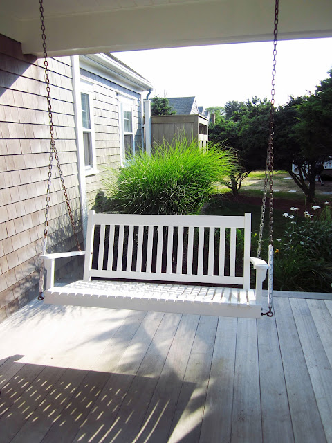 bench porch swing in the front yard