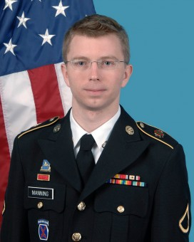 Bradley Manning in uniform in front of a US flag