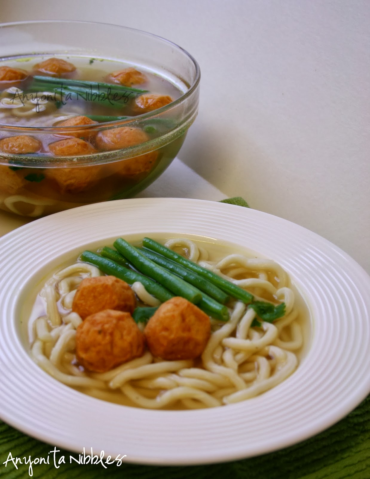 A bowl of Tom Yum Fish Ball Noodle Soup