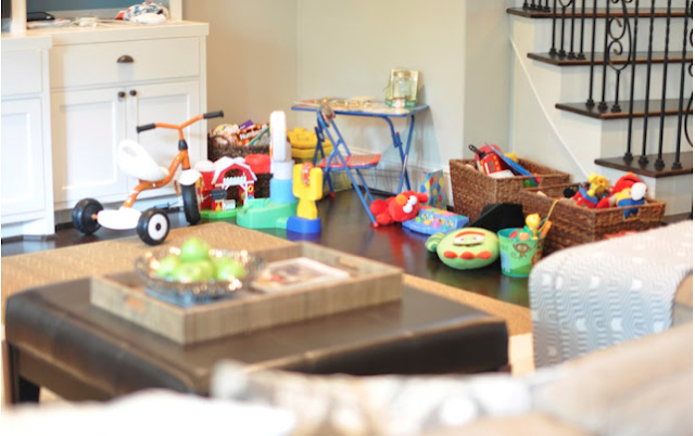 Honey we 39 re home our living room toy organization for How to organize toys in living room